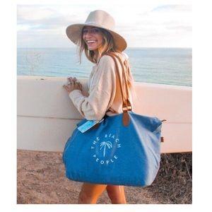 The Beach People Gold Cost Weekender Bag.